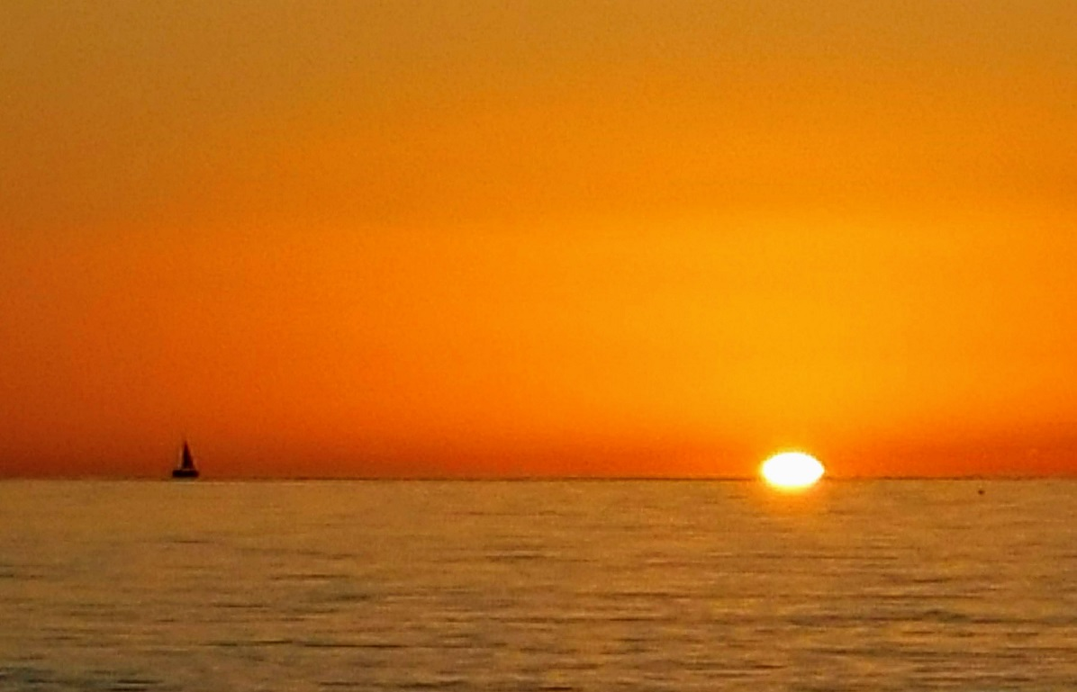Sailboat With Orange Sky